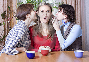 Two Women Share Secrets With A Friend Royalty Free Stock Photo - Image: 17211625
