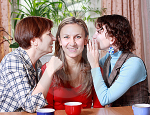 Two Women Share Secrets With A Friend Royalty Free Stock Photography - Image: 17211627