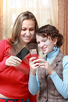 Two Girls With Mobile Phones Royalty Free Stock Photography - Image: 17211647