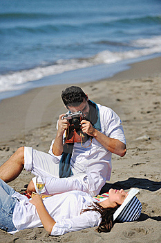 Happy Young Couple Have Fun At Beautiful Beach Stock Photo - Image: 17212360