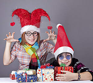 Two Funny Girls With Christmas Gifts. Stock Photography - Image: 17221162