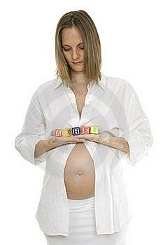 Beautiful Pregnant Woman Holding Baby Blocks Stock Photos - Image: 17239833