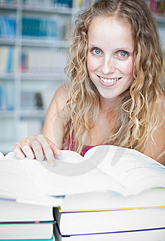 Pretty Female College Student In A Library Royalty Free Stock Images - Image: 17251739