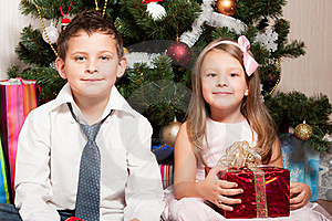 Girl And Boy Near A Fir-tree Royalty Free Stock Image - Image: 17269916