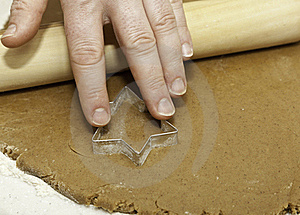 Pressing Cookie Cutter Into Dough Royalty Free Stock Image - Image: 17299216