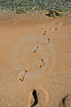 Footsteps on sand Royalty Free Stock Images