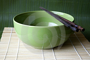 Green Bowl On Bamboo Pad Stock Photography - Image: 17301032