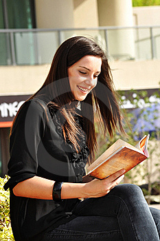 Young Beautiful Woman Reading A Book Stock Images - Image: 17306344
