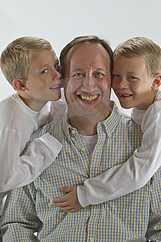Happy Dad Gets A Fathers Day Hug And A Kiss Royalty Free Stock Photo - Image: 17314575