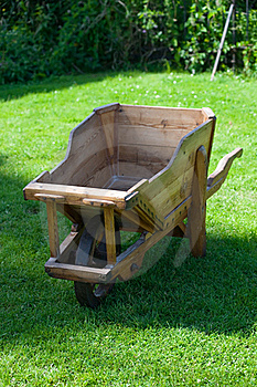 Wooden Trolley On Green Grass In The Garden Stock Images - Image: 17314714