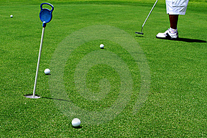 Golfer Putting A Golf Ball Stock Image - Image: 17320401