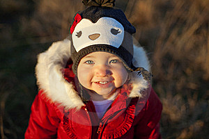 Cute Girl In Penguin Hat Smiling Stock Photo - Image: 17323470