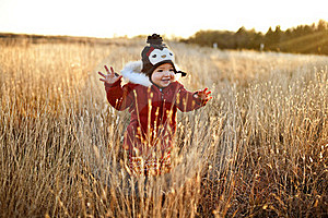 Cute Girl Running Through A Field At Sunset Royalty Free Stock Image - Image: 17323496