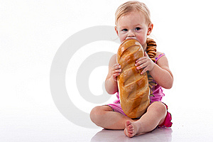 Baby Biting A Loaf Of Bread In Roll Beads Royalty Free Stock Images - Image: 17325269