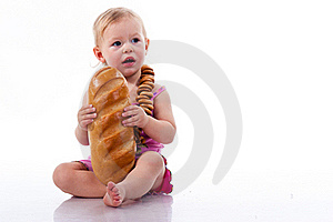Baby Holding A Loaf Of Bread In Roll Beads Royalty Free Stock Image - Image: 17325286