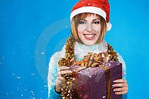 Festive Girl With Christmas Gift Stock Photos - Image: 17335673