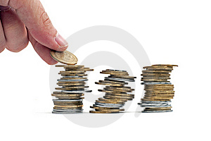 Arm Puts A Coin In A Pile Stock Photo - Image: 17336350