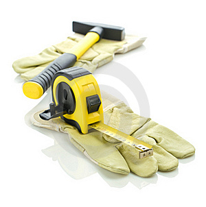 Gloves With Measuring Tape And Hammer Royalty Free Stock Photography - Image: 17357197