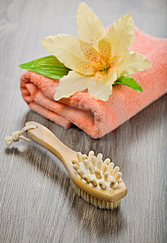 Flower On Pink Towel With Massager And Brush Stock Photo - Image: 17360450