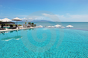Tropical Resort. Poolside And A Sea View Stock Photography - Image: 17372532