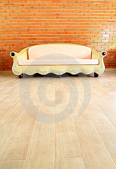 Brick Wall With A Rattan Sofa Stock Photography - Image: 17374242