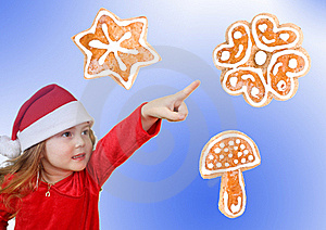 Little Girl In Christmas Hat Pointing Royalty Free Stock Photo - Image: 17391095