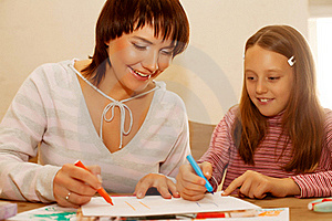 Mom And Daughter Painting On Paper Royalty Free Stock Photo - Image: 17392585