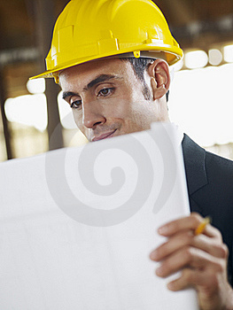 Architect With Blueprint In Construction Site Stock Photo - Image: 17401850