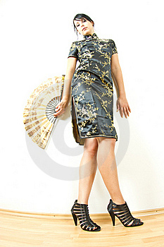 Woman In Chinese Dress With Fan Royalty Free Stock Photography - Image: 17404517