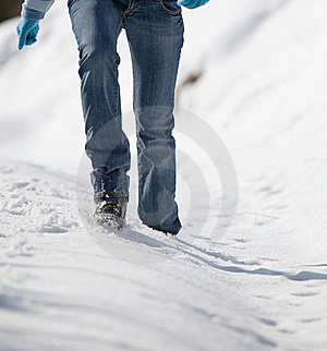 Woman Walking In Deep Snow Stock Image - Image: 17404621