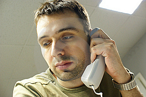 Caucasian Man With Phone In Office Royalty Free Stock Image - Image: 17426456