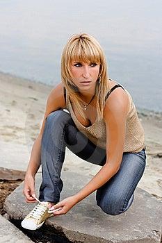 Girl Tying Shoelaces Royalty Free Stock Image - Image: 17430306