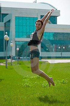 The Beauty Wet Brunette Jumps On The Grass Royalty Free Stock Photo - Image: 17432255