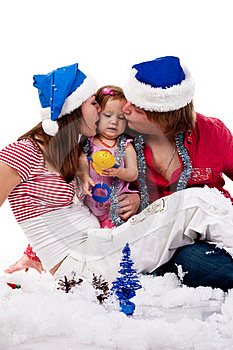 Parents In Santa's Hat Kissing Their Child Royalty Free Stock Photos - Image: 17443858