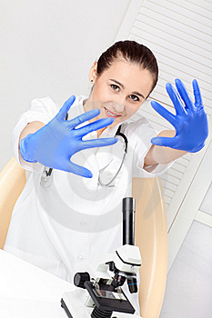 Medical - Female Nurse Looking In Microscope Royalty Free Stock Photo - Image: 17448335