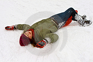 Girl Has Fun Lying In The Snow Stock Image - Image: 17448811