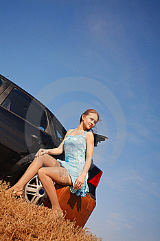 Girl With Suitcase Near The Car Royalty Free Stock Photo - Image: 17454015