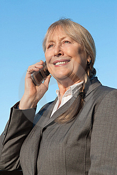 Happy Mature Businesswoman Using Cellphone. Royalty Free Stock Photography - Image: 17454987