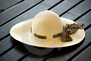 Women's Sun Hat On The Wooden Decking Stock Photos - Image: 17459043