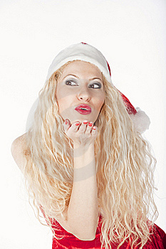 Sexy Blonde Girl Dressed As Santa Blowing A Kiss Royalty Free Stock Images - Image: 17470119