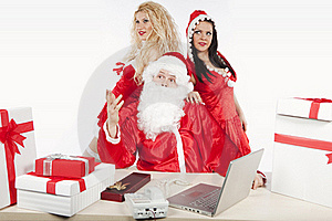 Santa Claus With Two Sexy Helpers In His Office Stock Photography - Image: 17470292