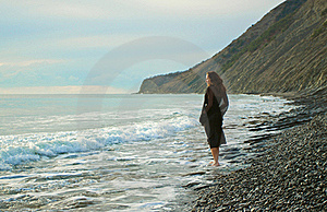 Barefooted Girl Goes Along Seashore Stock Photo - Image: 17476080