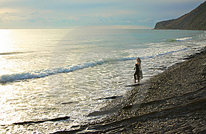 Barefooted Girl Goes Along Seashore Royalty Free Stock Image - Image: 17476196
