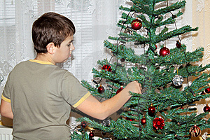 Young Boy Holding Christmas Decorations Stock Image - Image: 17495211