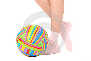Human Legs With A Multicolored Ball Stock Image - Image: 17495441