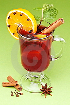 Glass Of Mulled Green On A Green. Stock Photos - Image: 17497503
