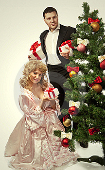 Victorian Couple Near A Christmas Tree Royalty Free Stock Photo - Image: 17515825