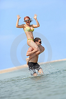 Happy Couple Having Fun On The Beach Royalty Free Stock Image - Image: 17515856