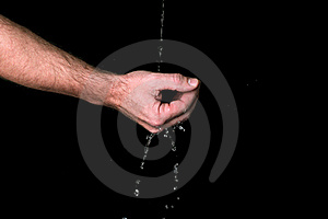 Water Runs Trough The Fingers Stock Images - Image: 17552014