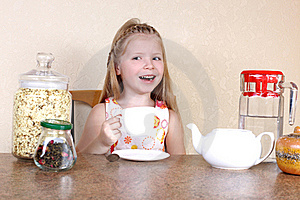 Little Girl With Cup Of Hot Drink Stock Image - Image: 17569001